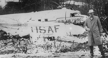 WFEA's Palmer Payne in front of the C-47 wreckage he survived in 1956