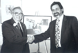 WFEA general manager Ray Garon congratulates Joe Maltais on his retirement - February 9, 1996